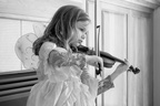 Playing dress-up and violin